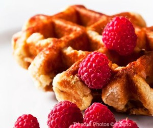 Delicious Belgian waffles from coconut flour garnished with fresh raspberries